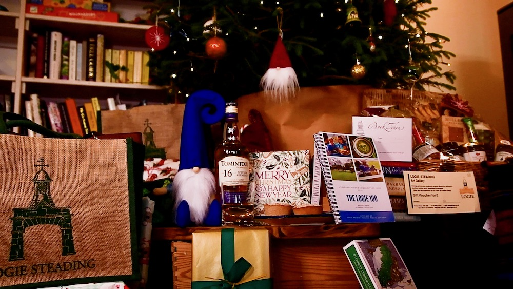 Logie Steading Christmas gifts around the tree