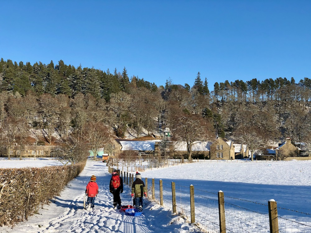 children walking to Logie Steading in the snow