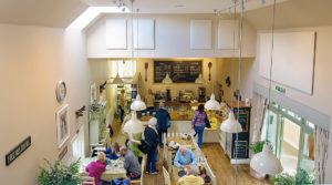 looking down at the counter from upstairs inside the Olive Tree Cafe at Logie Steading