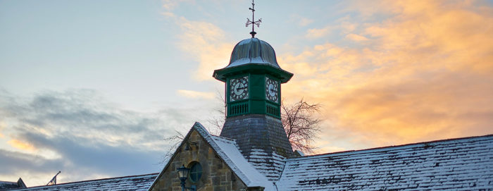 wintery clock tower at Logie Steading