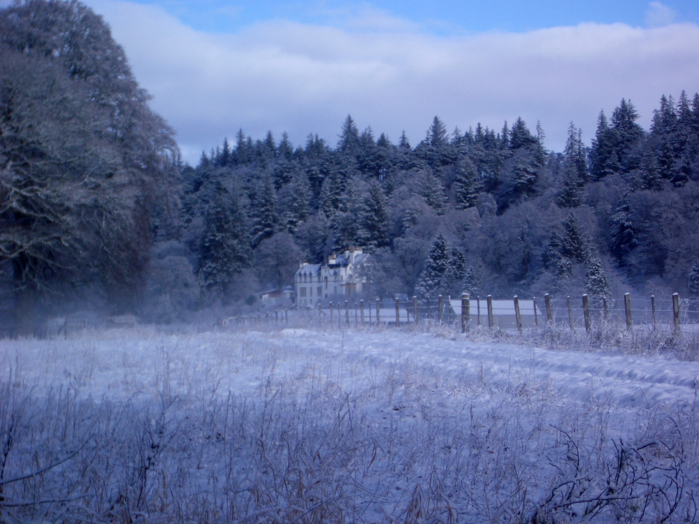 a snowy walk at Logie Steading: Logie House in the snow