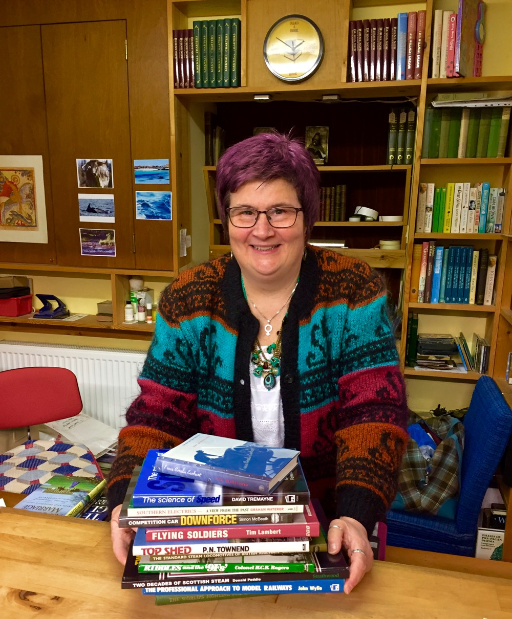 Ruth Boardman manning the desk of her Logie Steading Bookshop