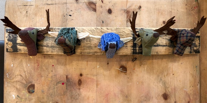mini Hellygog Heads on a whisky stave coat hooks
